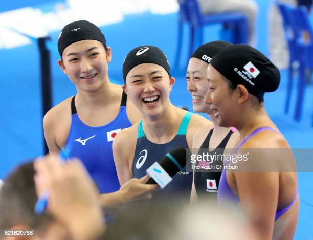 Rikako Ikee Yui Yamane Chihiro Igarashi and Tomomi Aoki of Japan are interviewed after competing in the Women's 4x100m Freestyle Relay on day ten of...