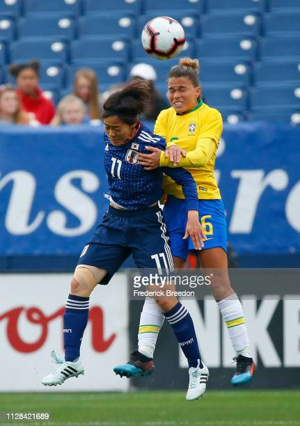 Rikako Kobayashi and Tamires of Brazil jump for a ball during the second half during the 2019 SheBelieves Cup match between Brazil and Japan at...