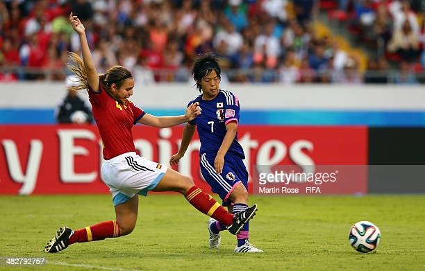 Rikako Kobayashi of Japan and Silvia Merida of Spain battle for the ball during the FIFA U17 Women's World Cup 2014 final match between Japan and...