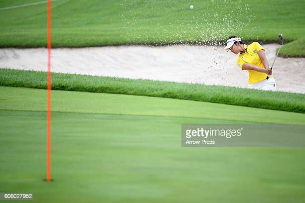 Rikako Morita of Japan hit from a bunker on the 1st green during the first round of the Munsingwear Ladies Tokai Classic 2016 at the Shin Minami...