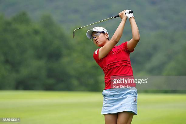 Rikako Morita of Japan hits her approach shot on the 4th hole during the first round of the Suntory Ladies Open at the Rokko Kokusai Golf Club on...