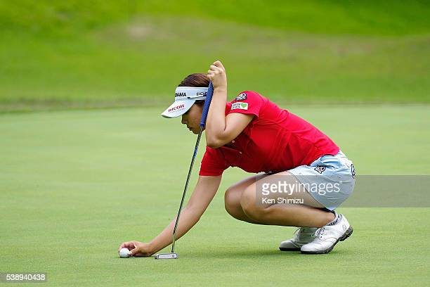 Rikako Morita of Japan lines up her putt on the 1st hole during the first round of the Suntory Ladies Open at the Rokko Kokusai Golf Club on June 9...