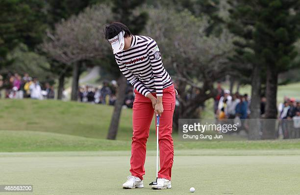 Rikako Morita of Japan plays a putt during the final round of the Daikin Orchid Ladies Golf Tournament at the Ryukyu Golf Club on March 8 2015 in...