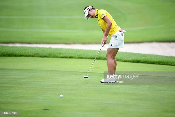 Rikako Morita of Japan putts on the 1st green during the first round of the Munsingwear Ladies Tokai Classic 2016 at the Shin Minami Aichi Country...