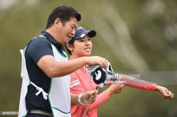 Rikako Morita of Japan speaks with her caddie during the first round of the 50th LPGA Championship Konica Minolta Cup 2017 at the Appi Kogen Golf...