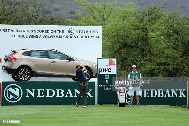 Rikard Carlberg tees off watched by caddie Mick Donaghy during a practice round ahead of the Nedbank Golf Challenge at Gary Player CC on November 9...
