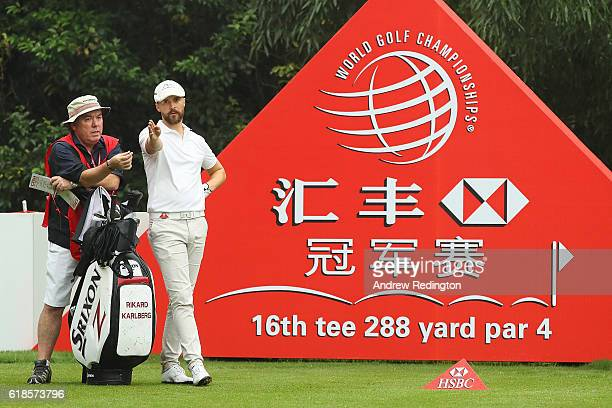 Rikard Karlberg of Sweden looks down the 16th hole with caddie Mick Donaghy during day one of the WGC HSBC Champions at Sheshan International Golf...
