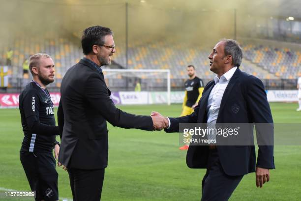 Rikard Norling, head coach of AIK and Darko Milanic head coach of Maribor shake hands during the Second qualifying round of the UEFA Champions League...