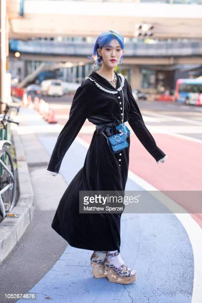 Rikarin is seen wearing black dress with blue bag and multicolor wooden heels during the Amazon Fashion Week TOKYO 2019 S/S on October 20 2018 in...