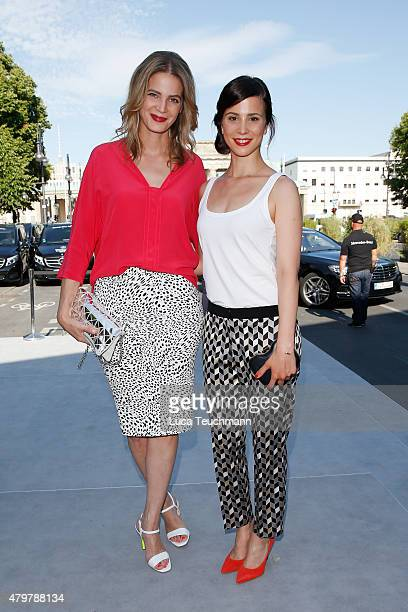 Rike Schmid and Aylin Tezel attend the Marc Cain show during the MercedesBenz Fashion Week Berlin Spring/Summer 2016 at Brandenburg Gate on July 7...