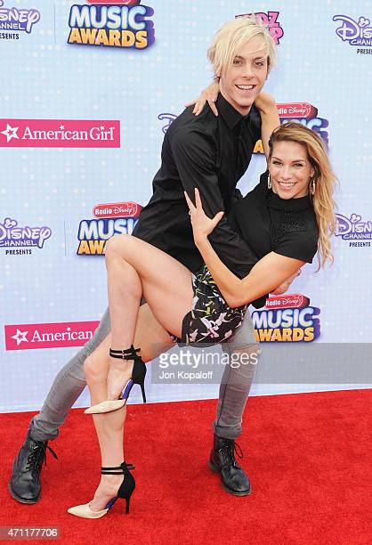 Riker Lynch and Allison Holker arrive at the 2015 Radio Disney Music Awards at Nokia Theatre LA Live on April 25 2015 in Los Angeles California