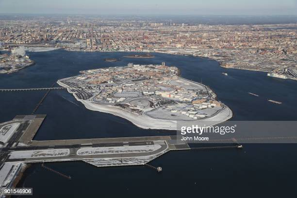 Rikers Island jail complex stands under a blanket of snow next to La Guardia Airport on January 5 2018 in the Bronx borough of New York City Under...