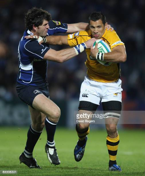 Riki Flutey of Wasps is held by Shane Horgan during the Heineken Cup match between Leinster and London Wasps at the RDS Ground on October 18 2008 in...