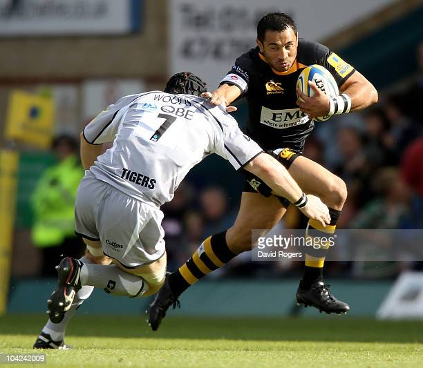 Riki Flutey of Wasps is tackled by Ben Woods during the Aviva Premiership match between London Wasps and Leicester Tigers at Adams Park on September...