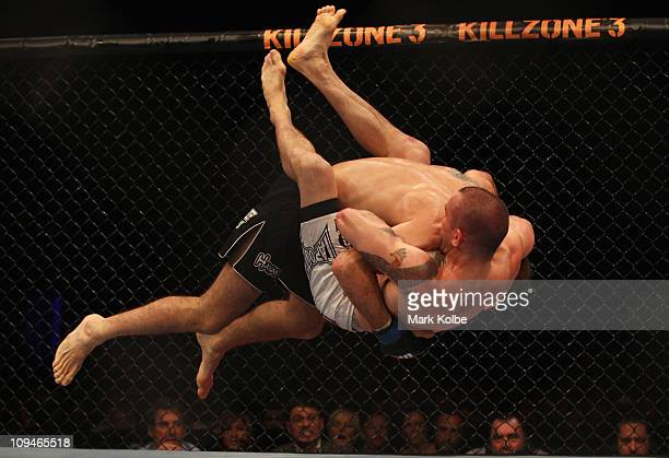 Riki Fukuda of Japan drives Nick Ring of Canada into the ground during their middleweight boutat UFC 127 at Acer Arena on February 27 2011 in Sydney...