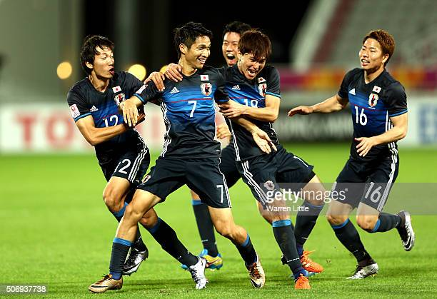 Riki Harakawa of Japan is congratulated by his team mates after scoring the winning goal during the AFC U23 Championship semi final match between...