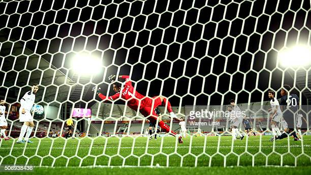 Riki Harakawa of Japan scores the winning goal during the AFC U23 Championship semi final match between Japan and Iraq at the Abdullah Bin Khalifa...