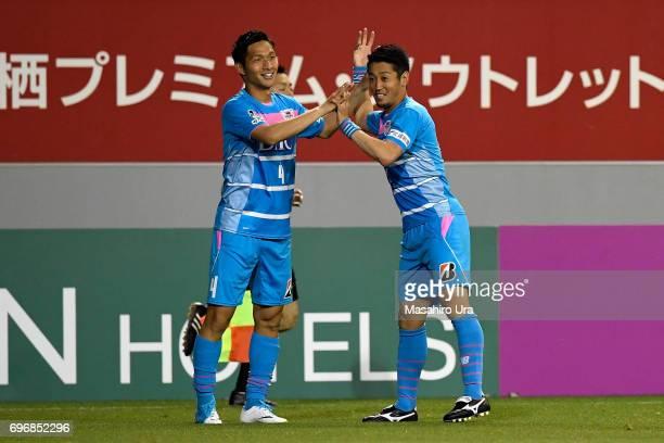 Riki Harakawa of Sagan Tosu celebrates scoring the opening goal with his team mate Yoshiki Takahashi during the J.League J1 match between Sagan Tosu...
