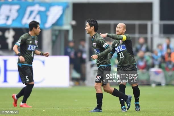 Riki Harakawa of Sagan Tosu celebrates scoring the opening goal with his team mate Yutaka Yoshida during the JLeague J1 match between Sagan Tosu and...