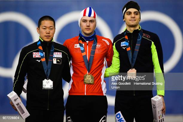 Riki Hayashi of Japan Allan Dahl Johansson of Norway and Paul Galczinsky of Germany stand on the podium after the men's 1500 meter final during day 3...