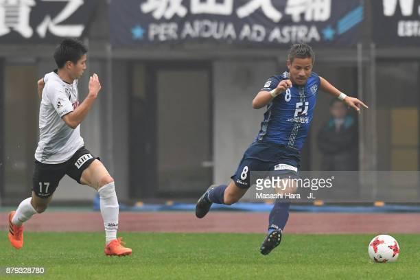 Riki Matsuda of Avispa Fukuoka and Tatsuya Uchida of Tokyo Verdy compete for the ball during the JLeague J1 Promotion PlayOff semi final match...