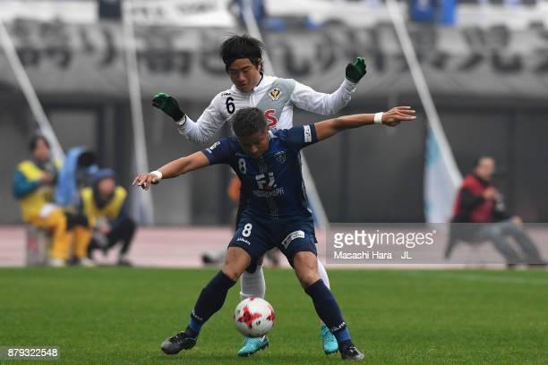 Riki Matsuda of Avispa Fukuoka controls the ball under pressure of Kazuki Anzai of Tokyo Verdy during the JLeague J1 Promotion PlayOff semi final...