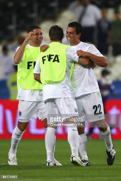 Riki van Steeden Milos Nikolic of Auckland City and Adam Dickinson of Auckland City celebrate the 20 victory after the FIFA Club World Cup match...