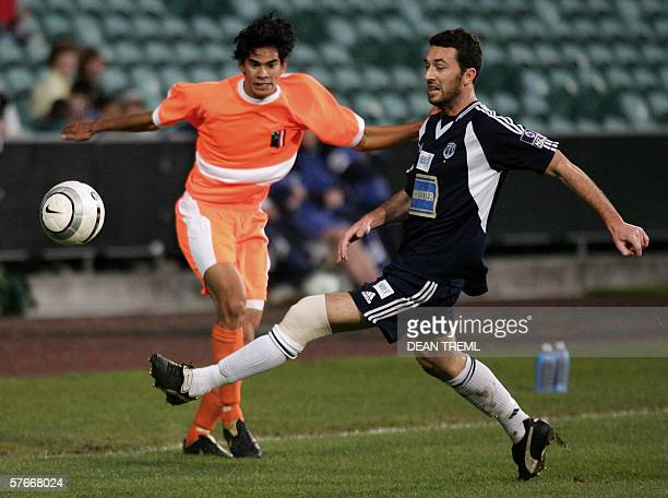 Riki Van Steeden of New Zealand's Auckland City FC clears the ball off Axel Willimas of Tahiti's AS Pirae during the final of the Oceania Football...