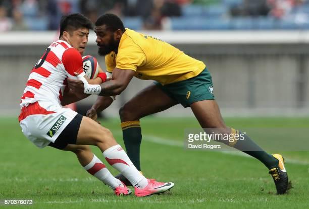 Rikiya Matsuda of Japan is tackled by Marika Koroibete during the rugby union international match between Japan and Australia Wallabies at Nissan...