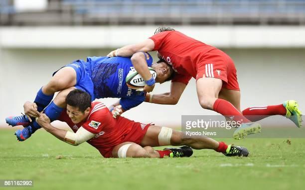 Rikiya Matsuda of Panasonic Wild Knights is tackled by Daiki Hashimoto of Kobe Kobelco Steelers during the second half of a Japan Rugby Top League...