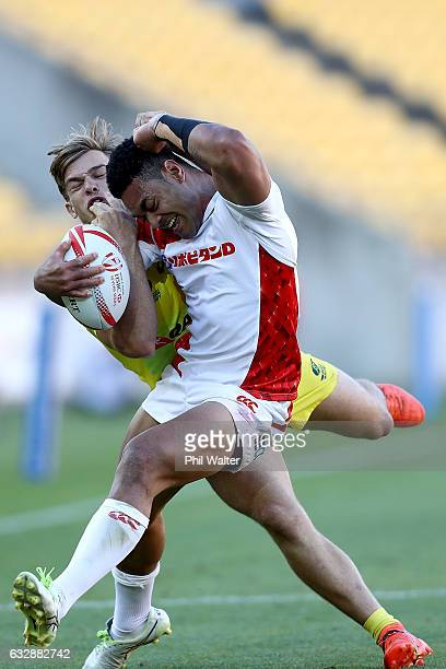 Rikiya Oishi of Japan is tackled by Charlie Taylor of Australia in the match between Japan and Australia during the 2017 Wellington Sevens at Westpac...
