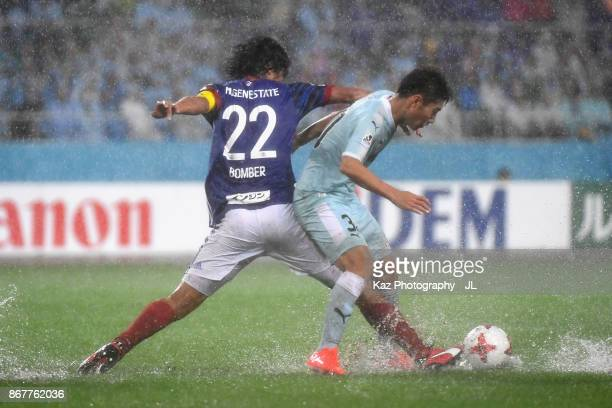 Rikiya Uehara of Jubilo Iwata and Yuji Nakazawa of Yokohama FMarinos compete for the ball during the JLeague J1 match between Jubilo Iwata and...
