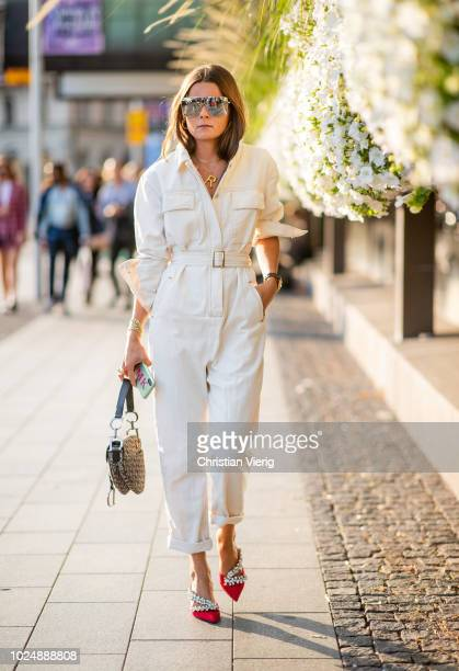 Rikke Krefting wearing white overall seen during Stockholm Runway SS19 on August 28 2018 in Stockholm Sweden