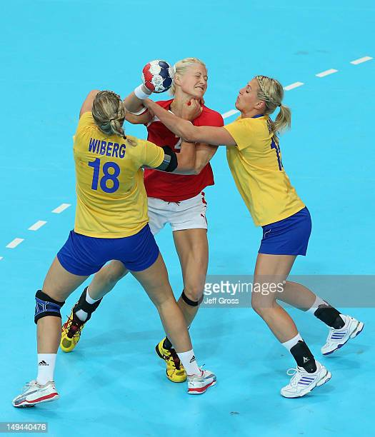 Rikke Skov of Denmark is closed down by Johanna Wiberg and Johanna Ahlm of Sweden in the Women's Handball preliminaries Group B Match 4 between...