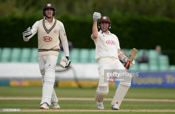 Rikki Clarke and Morne Morkel of Surrey celebrate their victory on the fourth day of the Specsavers County Championship Division One match between...