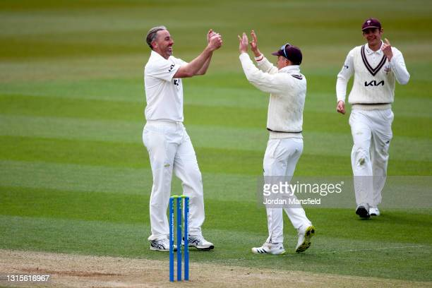 Rikki Clarke and Ollie Pope of Surrey celebrate dismissing Joe Weatherley of Hampshire during day three of the LV= Insurance County Championship...