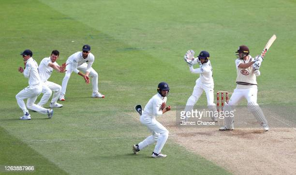 Rikki Clarke of Surrey bats as Nick Gubbins, Nathan Sowter, Stephen Eskinazi, Max Holden and John Simpson, Wicketkeeper of Middlesex field during Day...