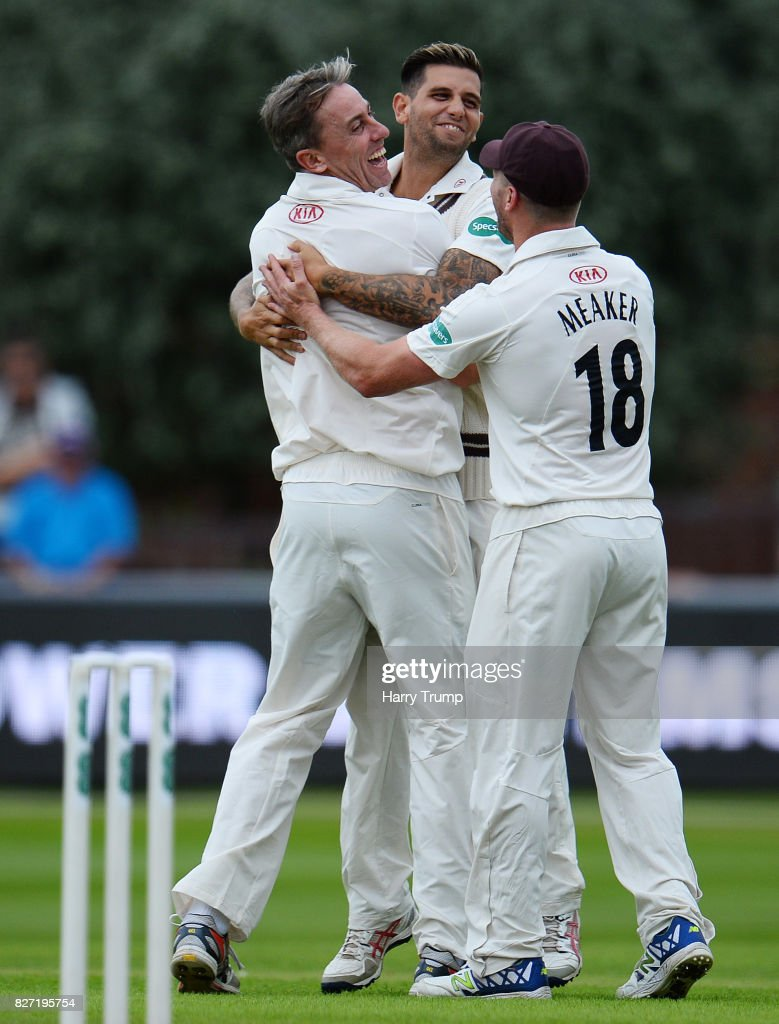 Rikki Clarke of Surrey(L) celebrates after dismissing Tim Rouse of Somerset during the Specsavers County Championship Division One match between Somerset and Surrey at The Cooper Associates County Ground on August 7, 2017 in Taunton, England.