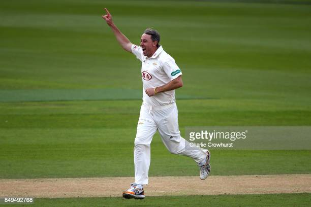 Rikki Clarke of Surrey celebrates after taking the wicket of Somerset's Tom Abel during day one of the Specsavers County Championship Division One...