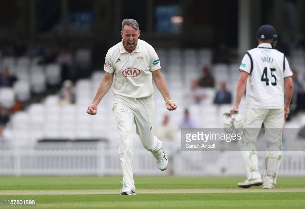 Rikki Clarke of Surrey celebrates after taking the wicket of Warwickshire's Will Rhodes during day one of the Specsavers County Championship match in...