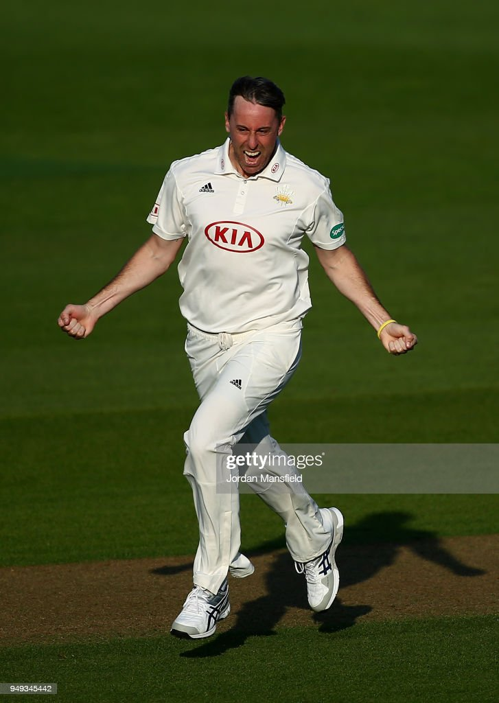 Rikki Clarke of Surrey celebrates dismissing Lewis McManus of Hampshire during day one of the Division One Specsavers County Championship match between Surrey and Hampshire at The Kia Oval on April 20, 2018 in London, England.