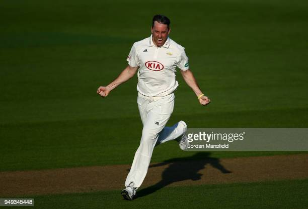 Rikki Clarke of Surrey celebrates dismissing Lewis McManus of Hampshire during day one of the Division One Specsavers County Championship match...