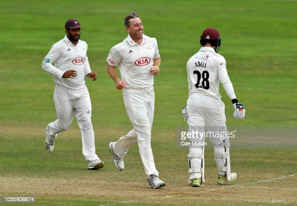 Rikki Clarke of Surrey celebrates taking the wicket of Tom Abell of Somerset during day two of the Specsavers County Championship Division One match...