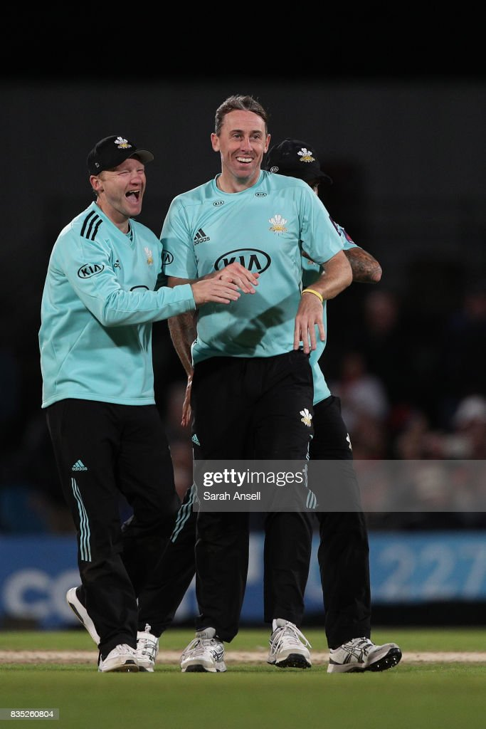 Rikki Clarke of Surrey (R) celebrates with captain Gareth Batty (L) after taking the wicket of Jimmy Neesham of Kent Spitfires during the NatWest T20 Blast South Group match between Kent Spitfires and Surrey at The Spitfire Ground on August 18, 2017 in Canterbury, England. (Photo by Sarah Ansell/Getty Images).