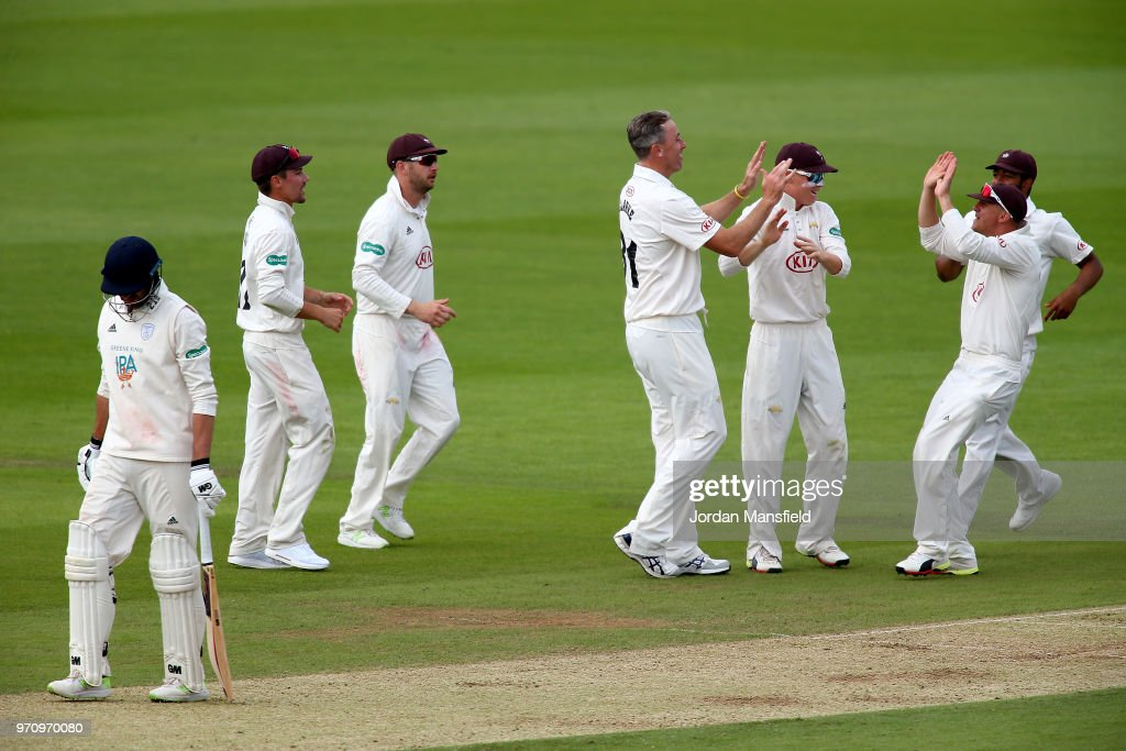 Rikki Clarke of Surrey celebrates with his teammates after dismissing James Vince of Hampshire as he walks off during the Specsavers County Championship Division One match between Hampshire and Surrey at Ageas Bowl on June 10, 2018 in Southampton, England.