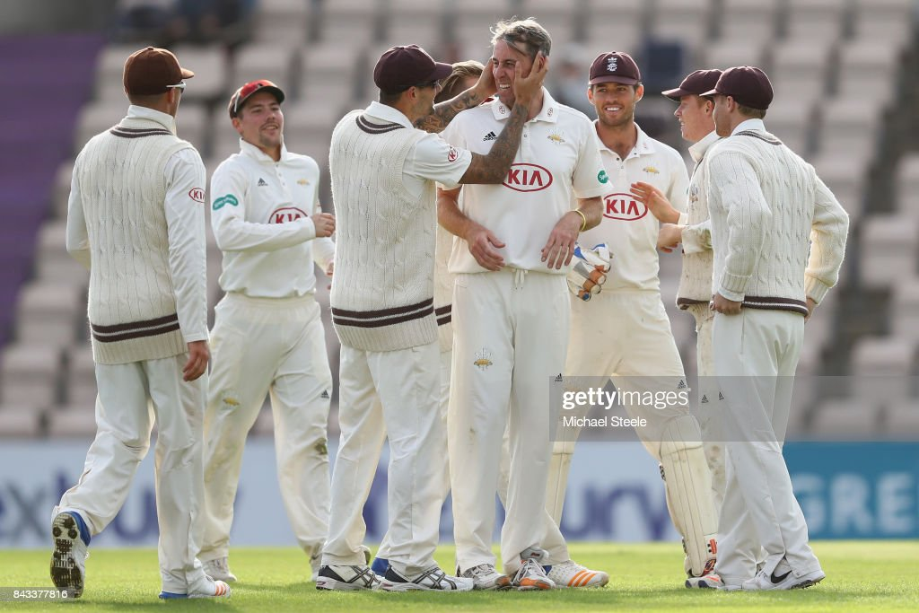 Rikki Clarke of Surrey is congratulated by Jade Dernbach after taking the wicket of Liam Dawson of Hampshire during day two of the Specsavers County Championship Division One match between Hampshire and Surrey at the Ageas Bowl on September 6, 2017 in Southampton, England.