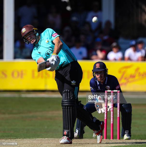 Rikki Clarke of Surrey plays a shot as Adam Wheater of Essex looks on during the Vitality Blast T20 match between Essex Eagles and Surrey at The...