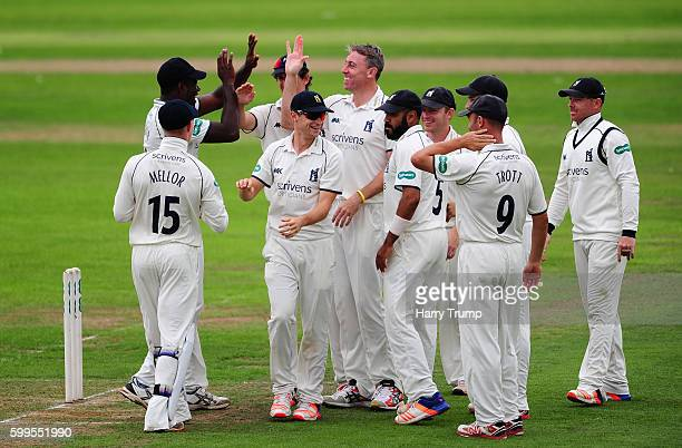 Rikki Clarke of Warwickshire celebrates the wicket of Lewis Gregory of Somerset during Day One of the Specsavers County Championship Division One...