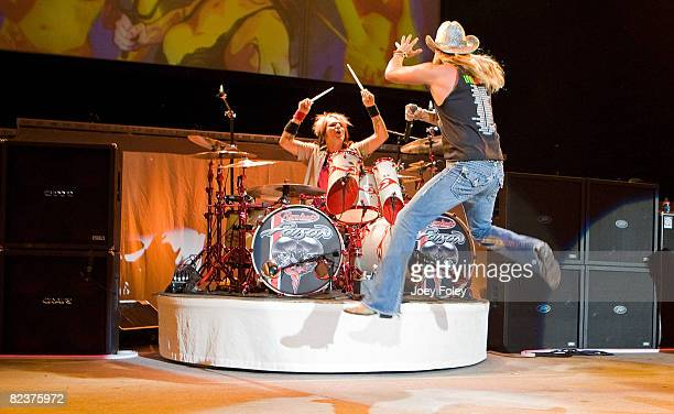 Rikki Rockett and Bret Michaels of Poison performs live in concert at the Verizon Wireless Music Center on August 15, 2008 in Noblesville,Indiana.