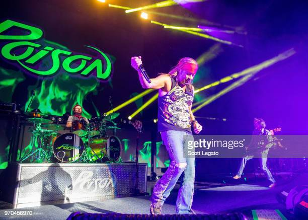 Rikki Rockett Bret Michaels and Bobby Dall of Poison perform during the Nothin' But a Good Time Tour 2018 at DTE Energy Music Theater on June 8 2018...